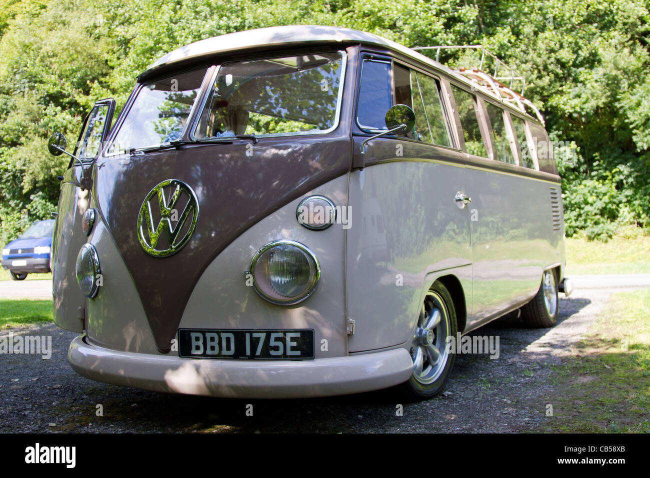 A lowered 1966 Split Screen VW Campervan, taken on a campsite in Devon on a sunny day - Stock Image