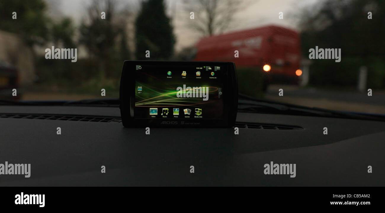 ARCHOS 5 Internet Tablet GPS On Dashboard Of Car - Stock Image