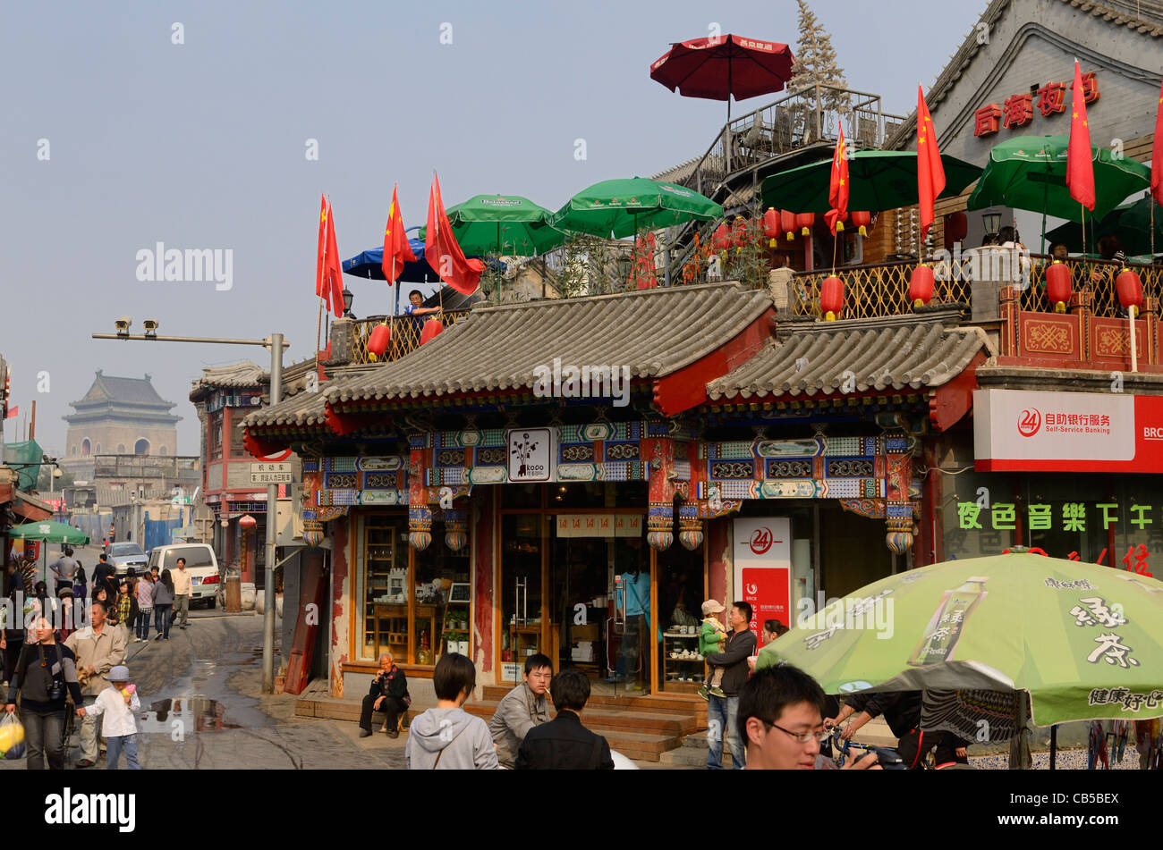 View of Hutong intersection and Bell Tower from Yinding bridge between Houhai and Qianhai lakes Beijing Peoples - Stock Image