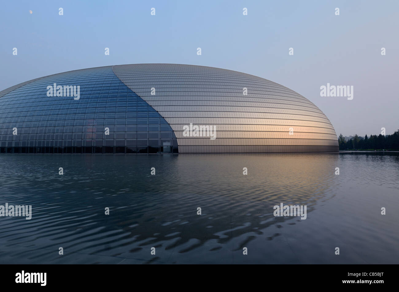 National Centre for the Performing Arts at dusk with moon in Beijing Peoples Republic of China - Stock Image