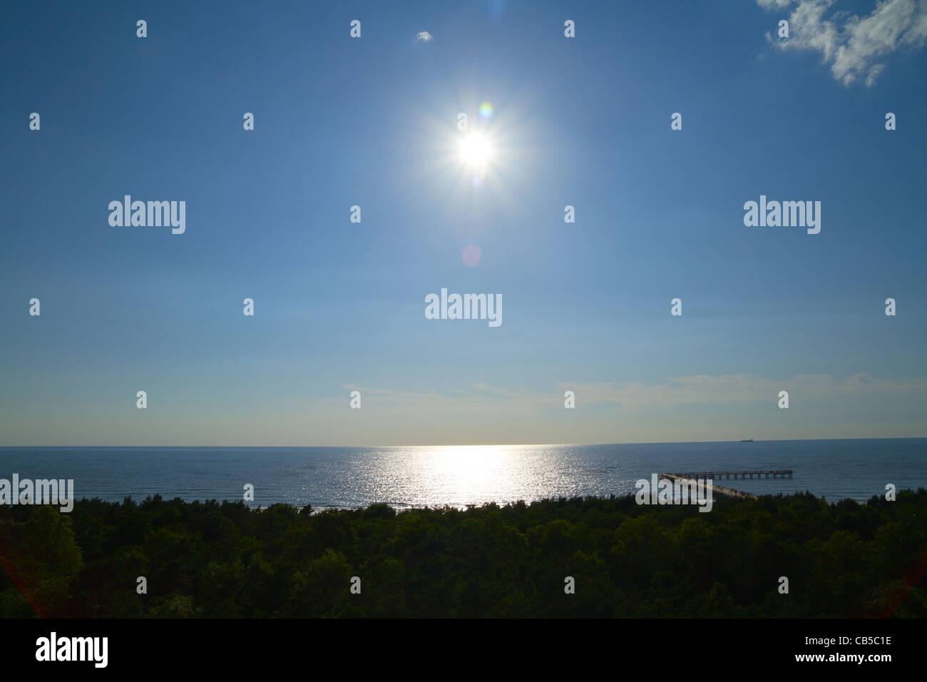 sea pier, sun - Stock Image