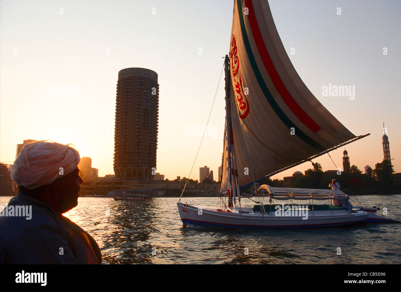 A small Nile river saling ferry carries a Coca-Cola logo on its sail, Cairo, Eygpt. - Stock Image