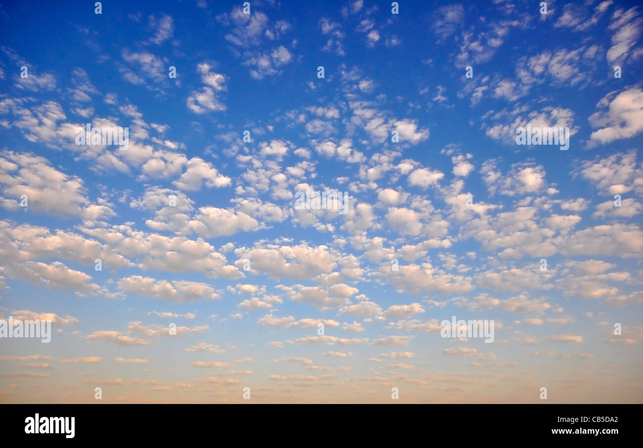 Blue sky with puffy white clouds - Stock Image