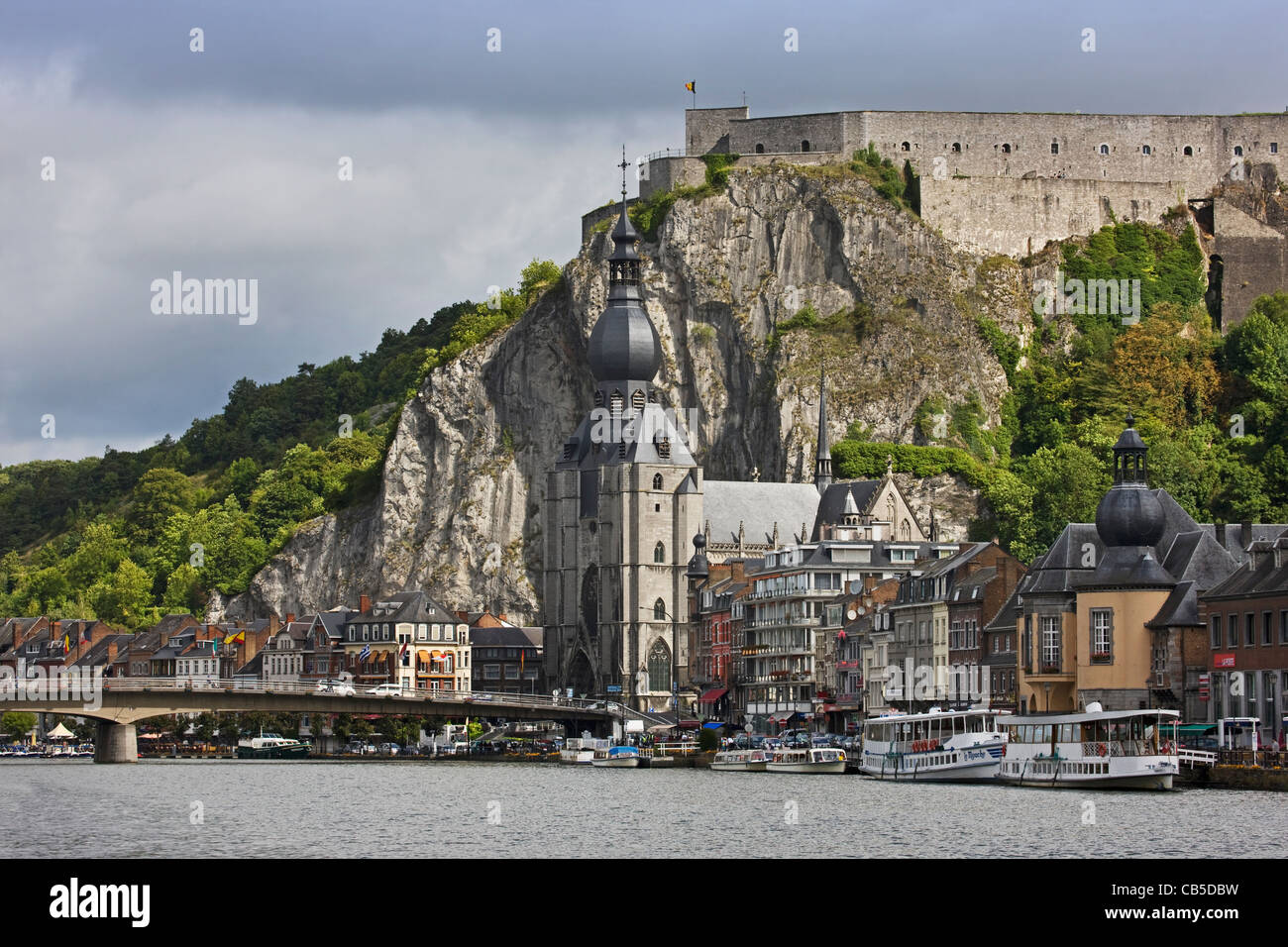 The citadel and Collegiate Church of Notre-Dame along the river Meuse at Dinant, Belgium - Stock Image