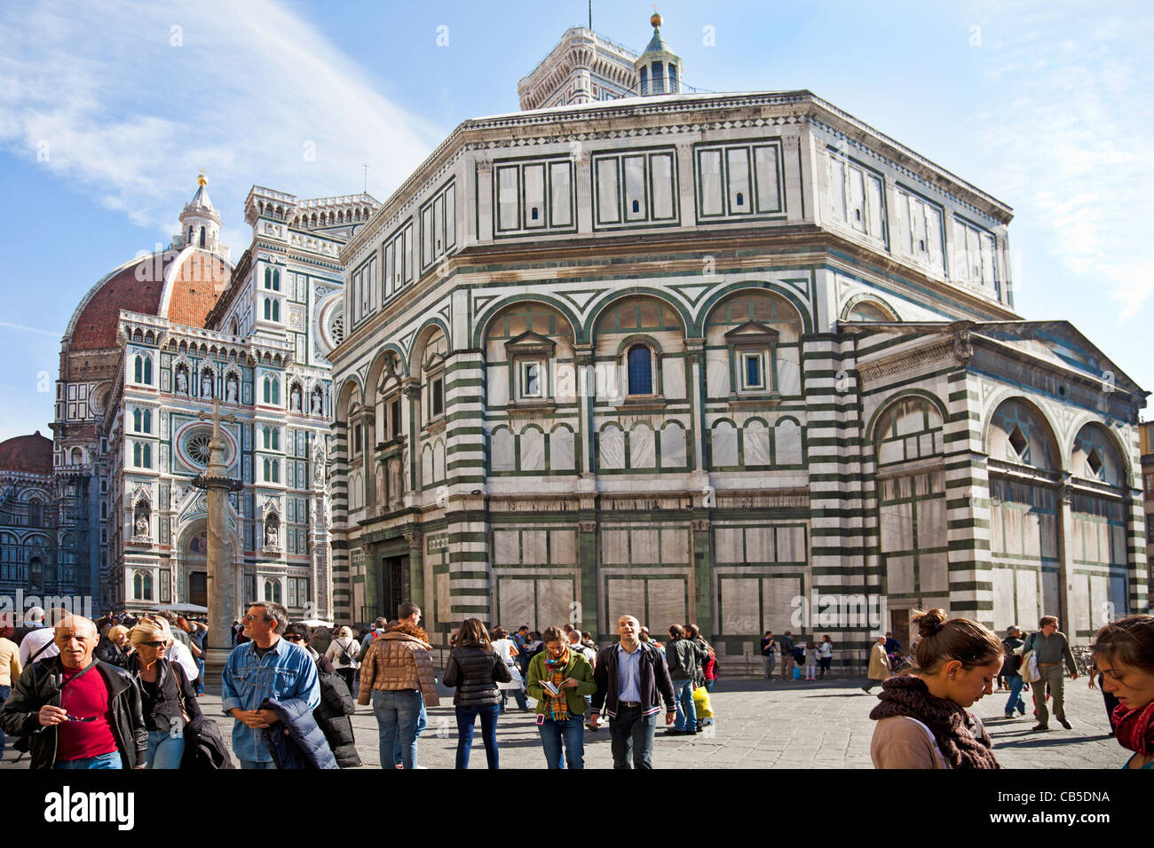 Tourists and locals outside the Battistero di San Giovanni, Baptistry of St John, in central Florence, Italy. Duomo - Stock Image