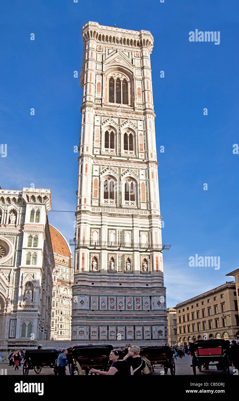 Tourists and locals outside Giotto's Campanile beside the Duomo in Florence, Tuscany, Italy, with horse and - Stock Image