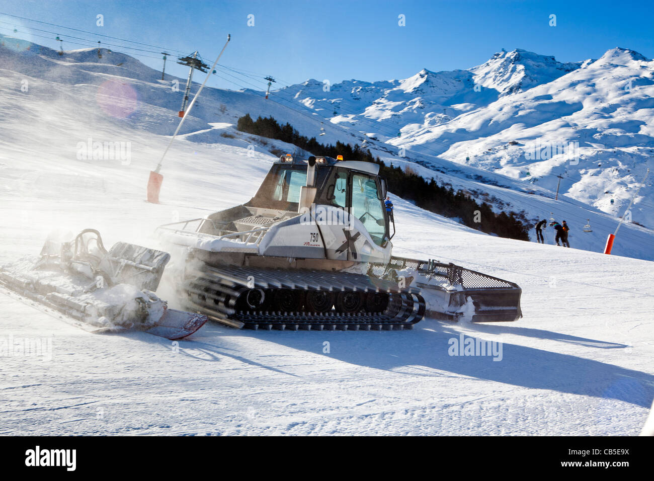 Piste Basher in the Three Valleys (Trois Vallees), Les Menuires, Savoie, France. - Stock Image