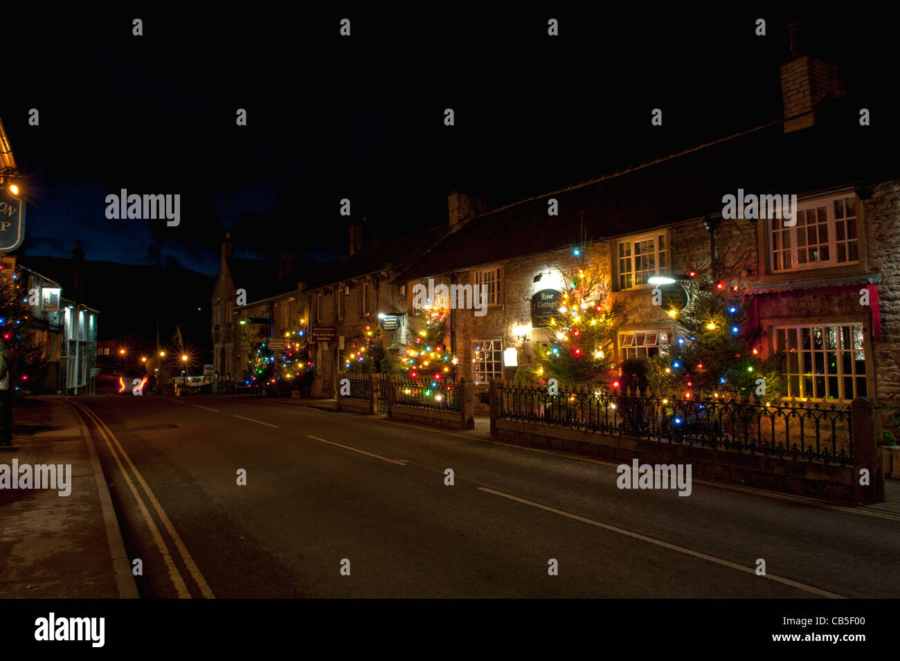 Christmas lights down the main street Castleton Derbyshire. Stock Photo