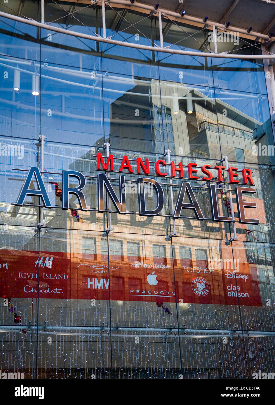 Piccadilly reflections in Arndale Glass walled Building Facade, Manchester, UK - Stock Image