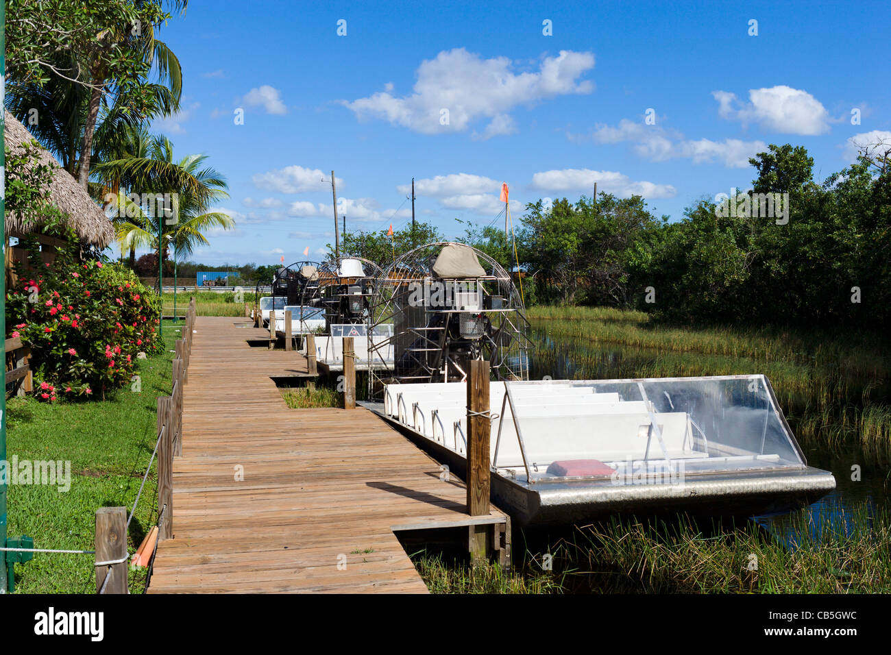 Airboats alongside the dock at Gator Park Airboat Tours on Highway 41 (Tamiami Trail), Florida Everglades, Florida, - Stock Image