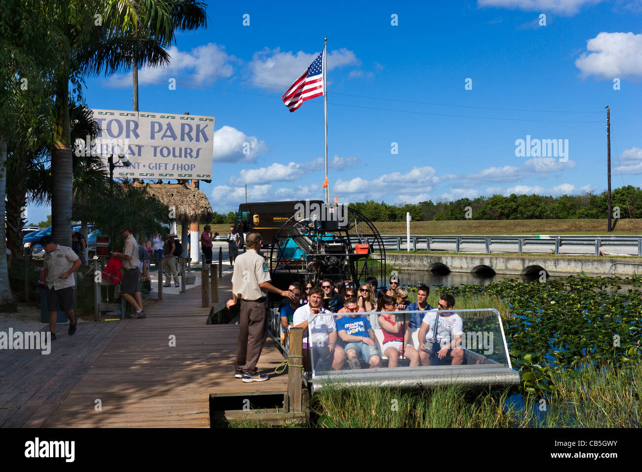 Airboat alongside the dock at Gator Park Airboat Tours on Highway 41 (Tamiami Trail), Florida Everglades, Florida, - Stock Image