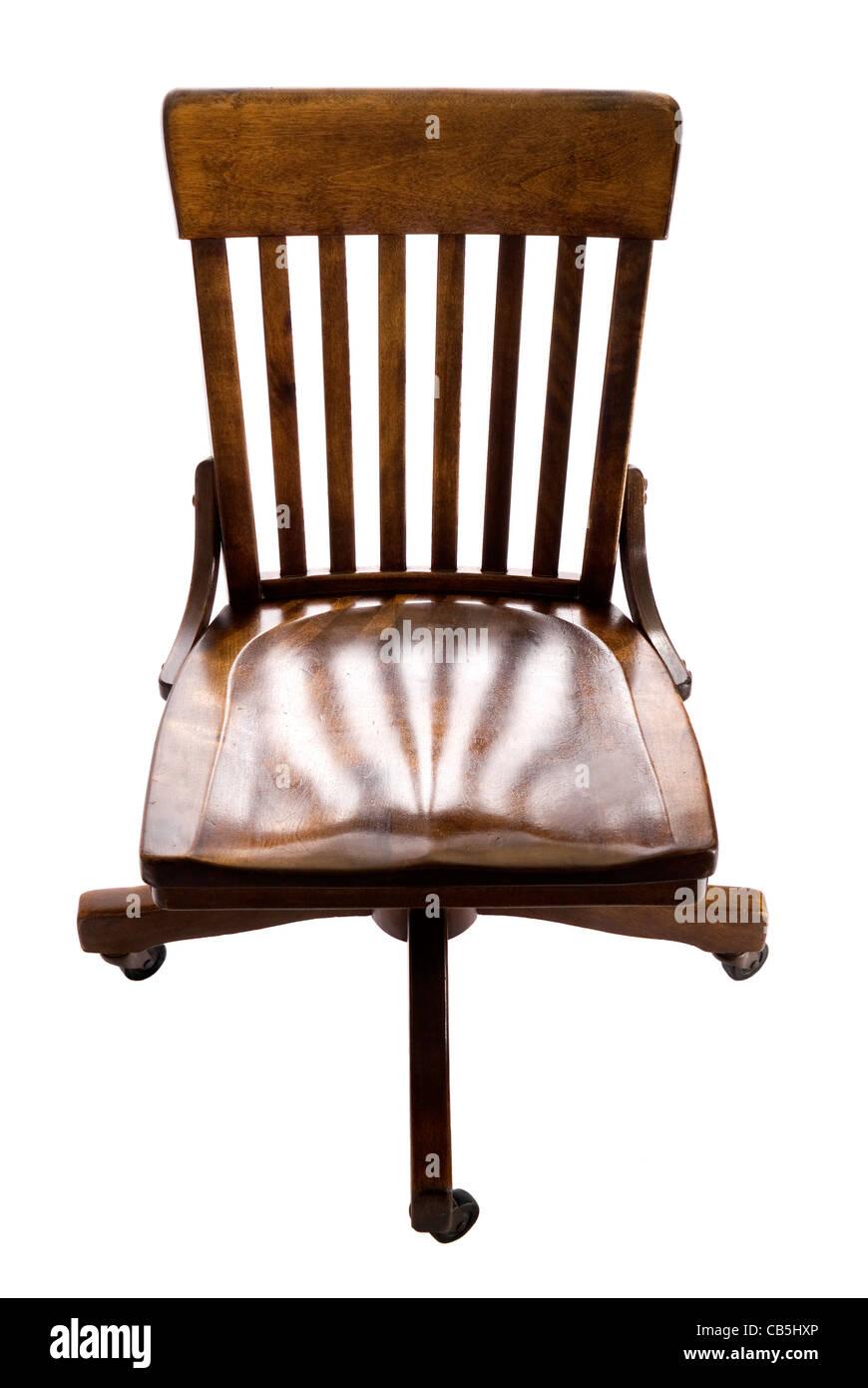 Antique oak swivel desk chair on wheels. - Antique Oak Swivel Desk Chair On Wheels Stock Photo: 41305790 - Alamy