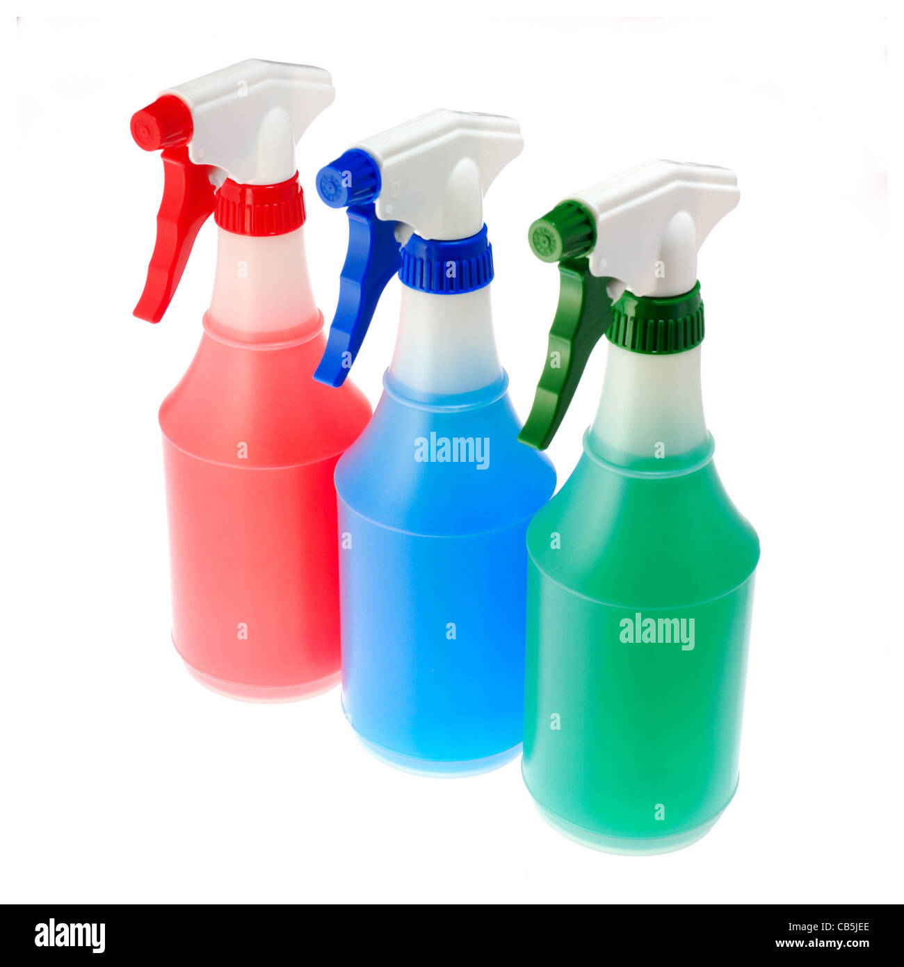 spray bottles of primary red blue green colors for mixing - Stock Image