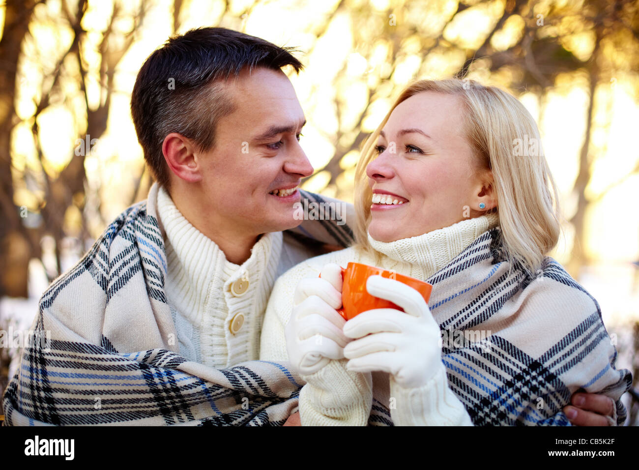Photo of happy man and pretty woman having nice time outdoor in winter - Stock Image