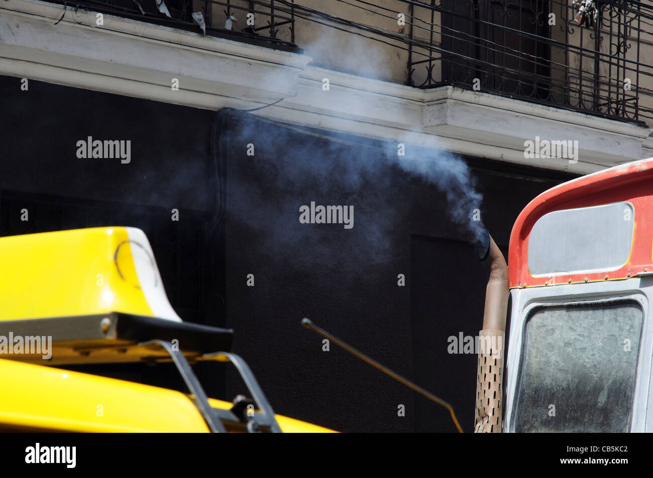 Smoke coming from an exhaust pipe in polluted La Paz, Bolivia - Stock Image