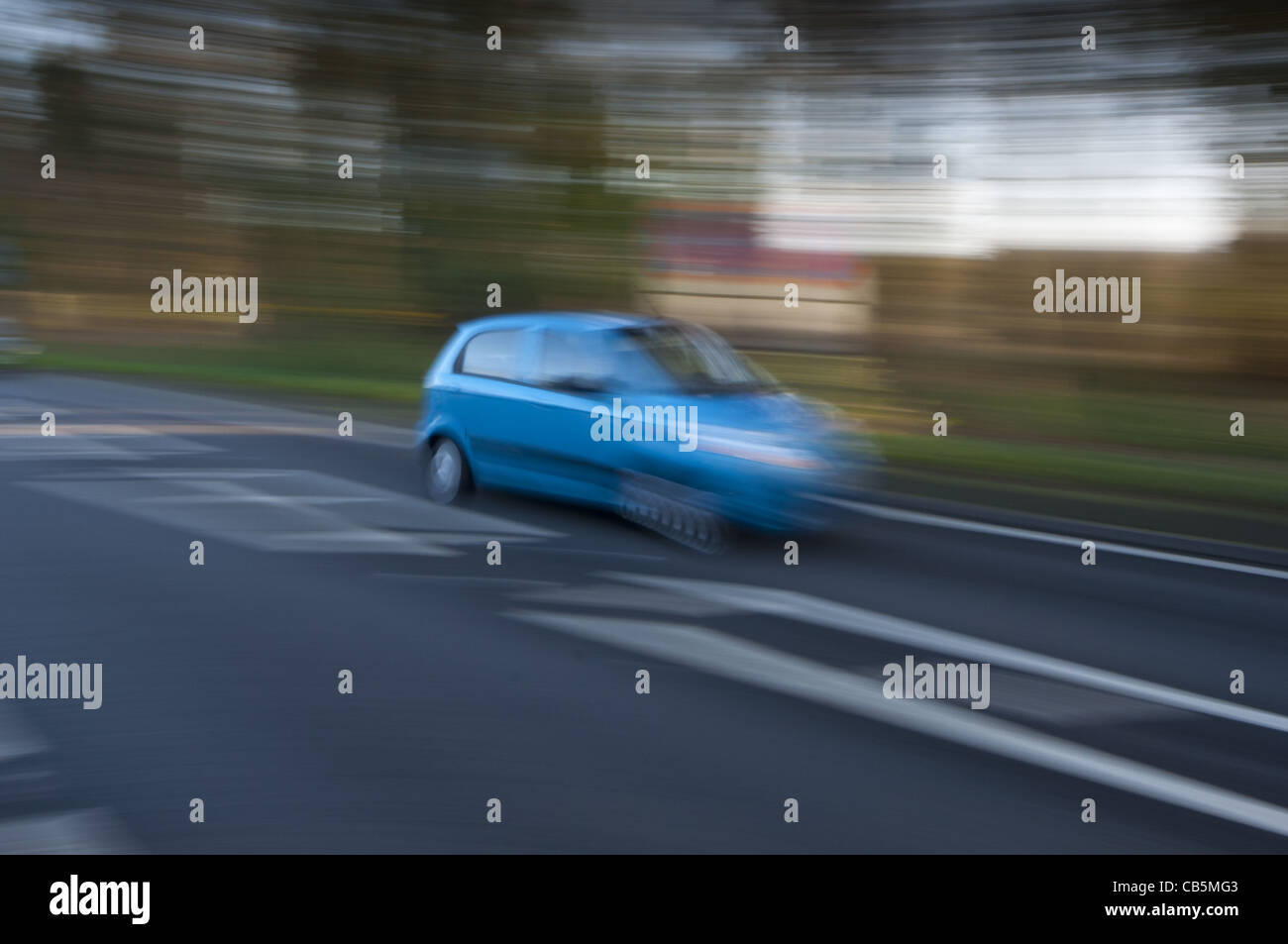 Traffic cars on country road with motion blur - Stock Image
