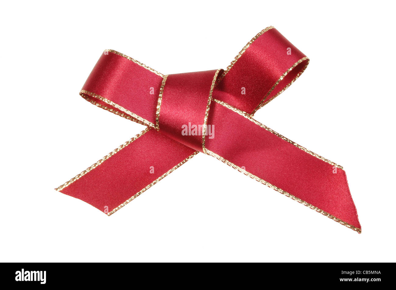Gold edged red ribbon bow isolated on white - Stock Image