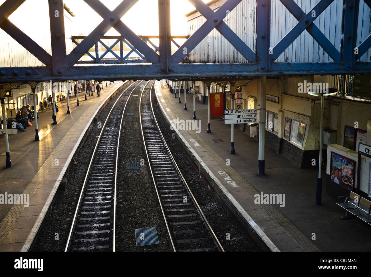 End of the day - low sunlight highlighting the tracks of a railway station. UK. - Stock Image