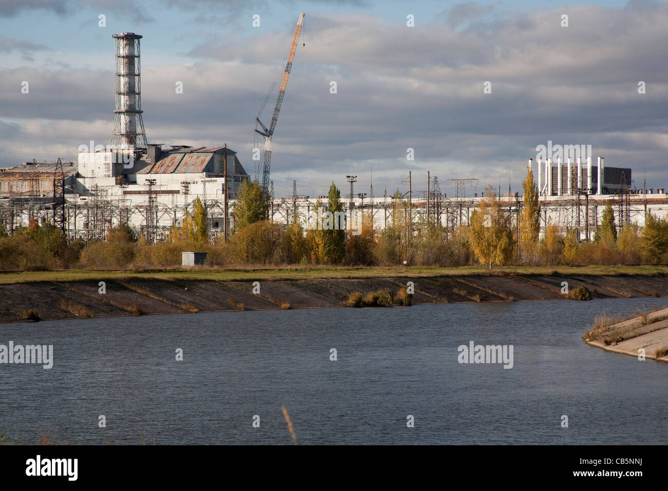 The Pripyat River or Prypiat River with the Chernobyl nuclear power plant in the background Chernobyl Ukraine - Stock Image