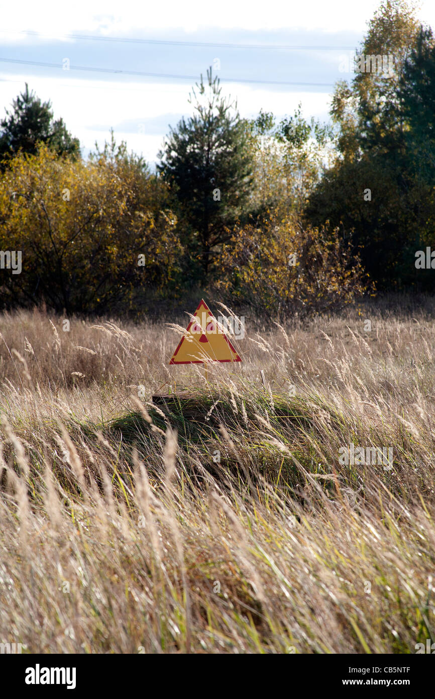 Radioactivity warning side in the countryside around the Chernobyl Power Plant, Chernobyl Ukraine - Stock Image