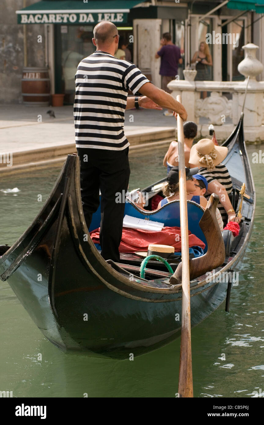 venice gondolier gondoliers italy italian canal canals - Stock Image