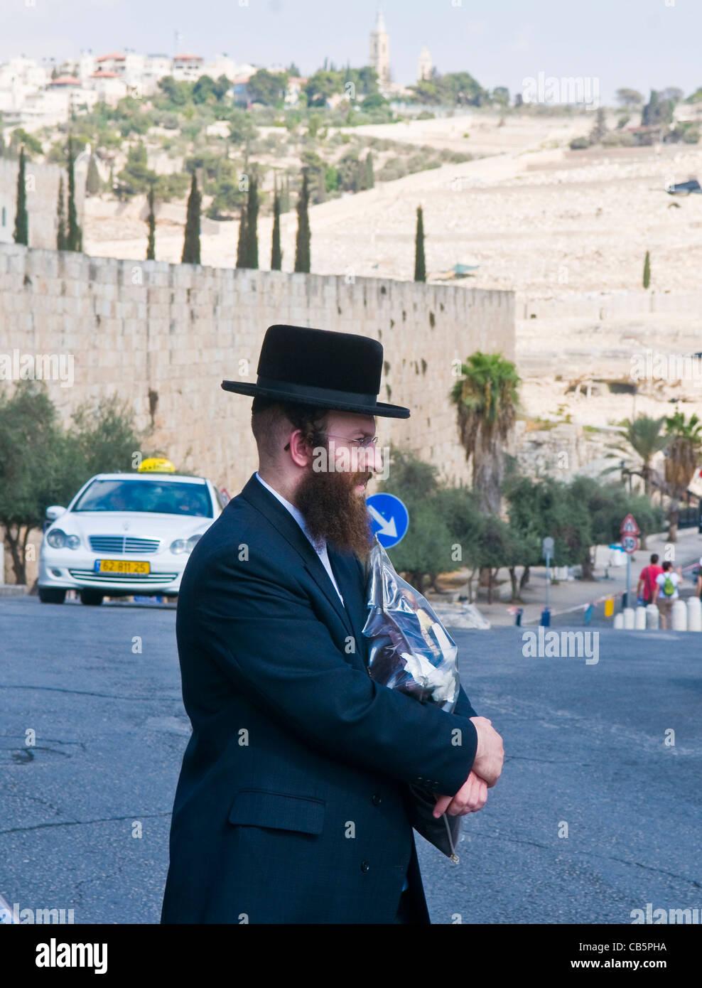 An ultra- Orthodox Jewish man stand near the walls of old Jerusalem , Israel - Stock Image