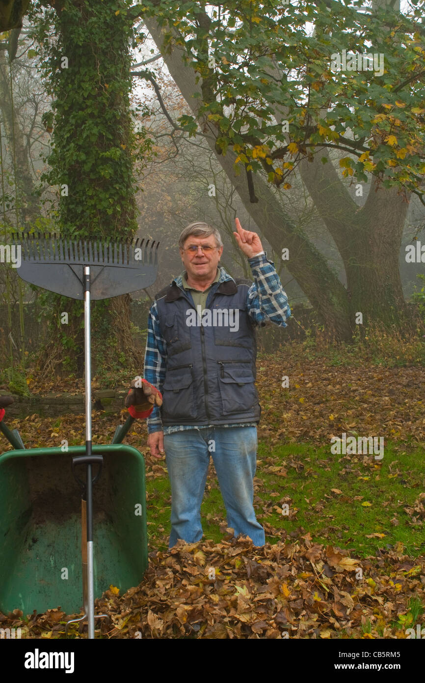 Me gesturing again pointing up to the offending tree that deposited its leaves on the ground. Stock Photo