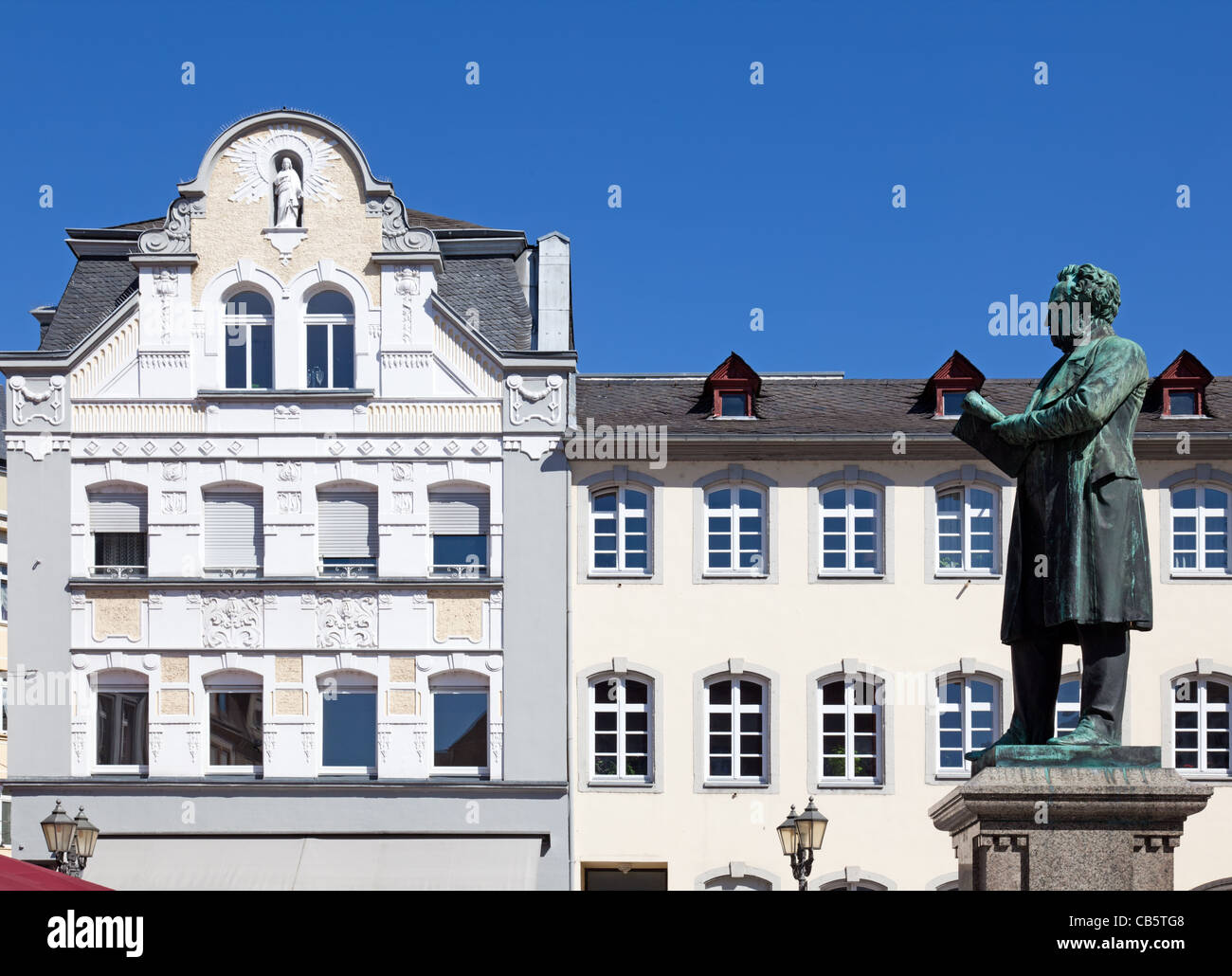 The statue of Johannes Mueller and historical buildings in the beautiful altstadt (old town) of Koblenz's Jesuits - Stock Image