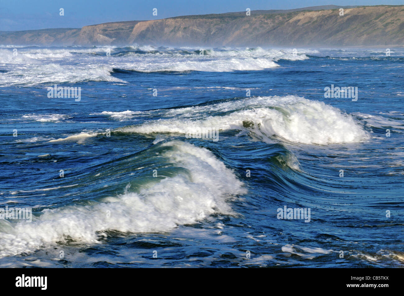 Portugal, Algarve: Waves at beach Praia da Bordeira - Stock Image
