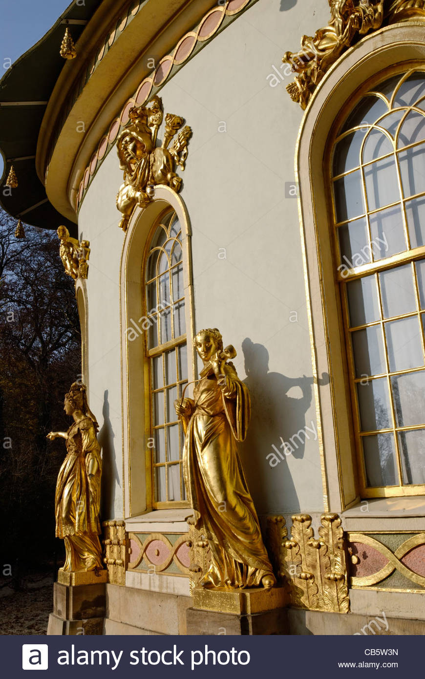 golden statues of female musicans at The Chinese House, a garden pavilion in Sanssouci Park in Potsdam - Stock Image