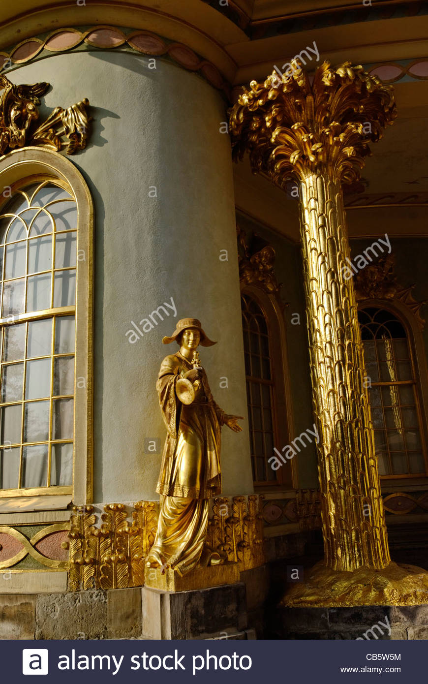 golden statue of a musican playing a horn at The Chinese House, a garden pavilion in Sanssouci Park in Potsdam - Stock Image
