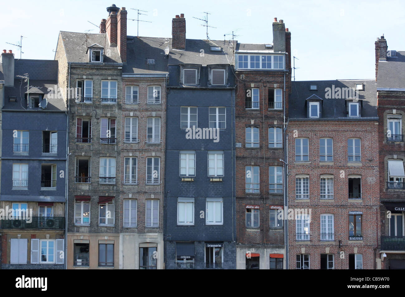 View of the port in Honfleur, Normandy, France. Houses with typical style, and old windows, boats, see - Stock Image