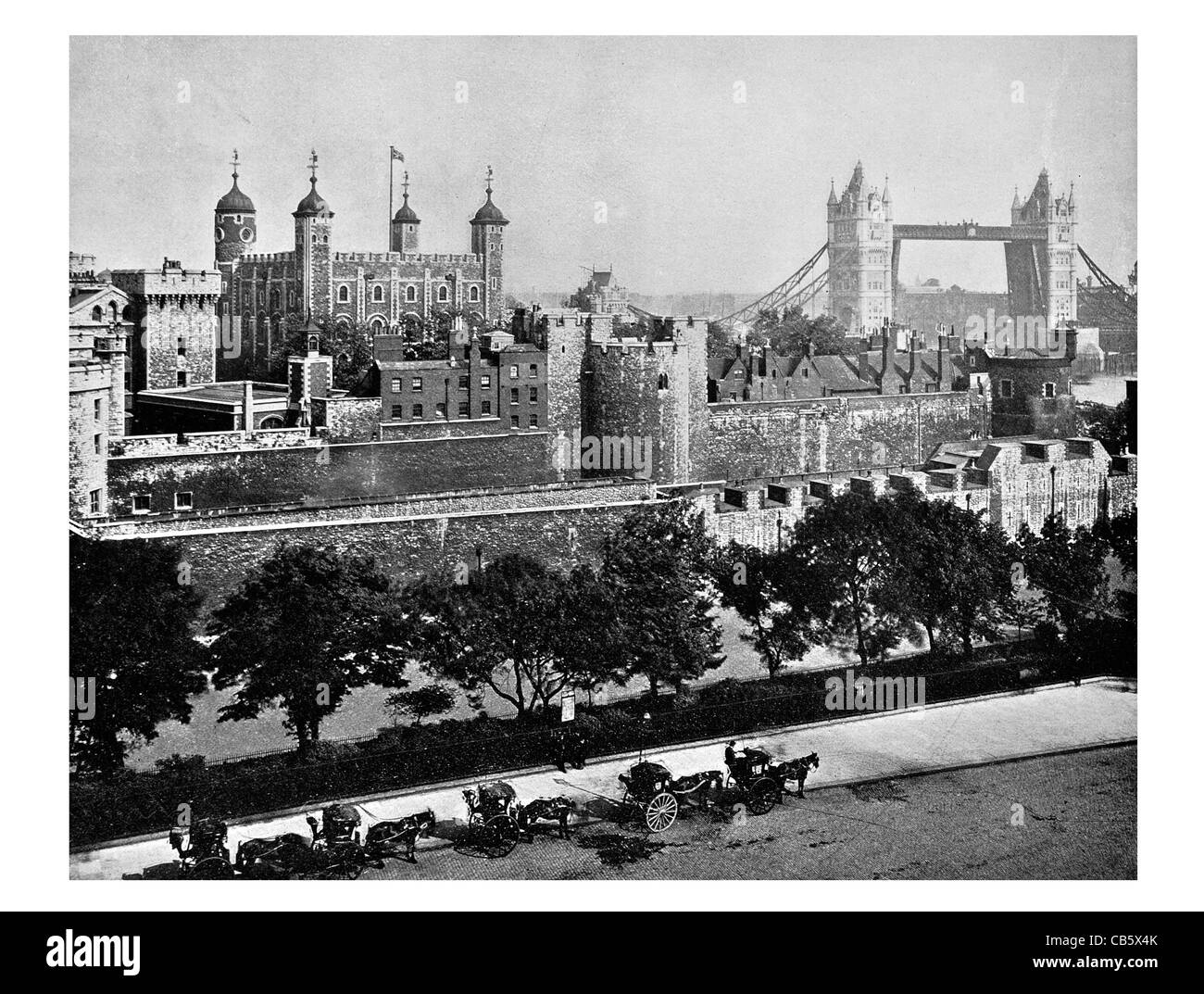 Tower of London Her Majesty's Royal Palace Fortress historic castle River Thames England Bridge turrets - Stock Image