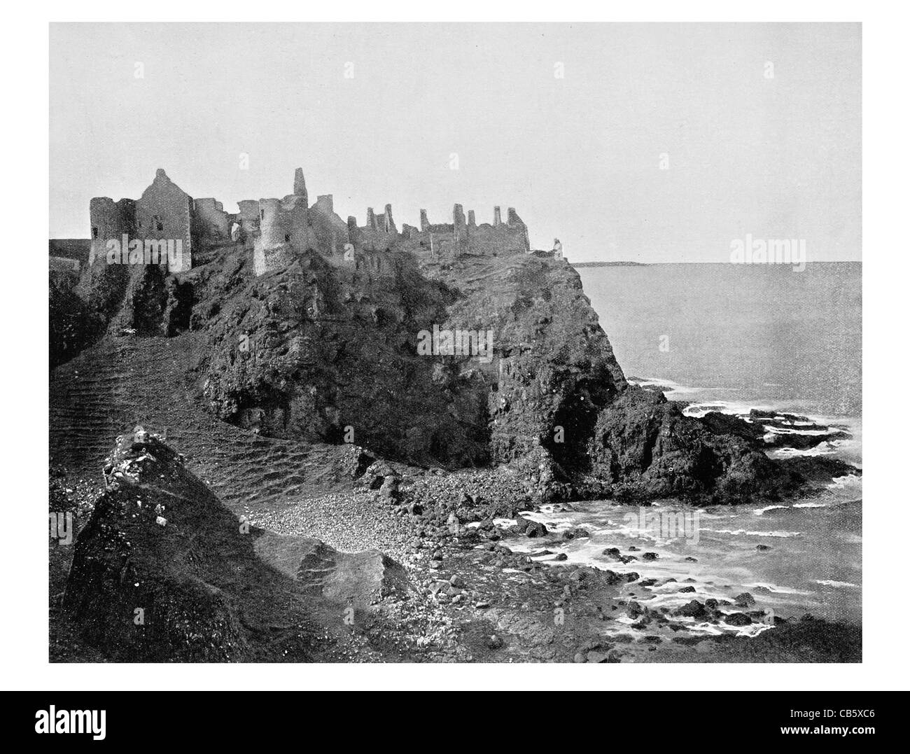 Dunluce Castle ruined ruin medieval Northern Ireland Viking Monument State Care - Stock Image