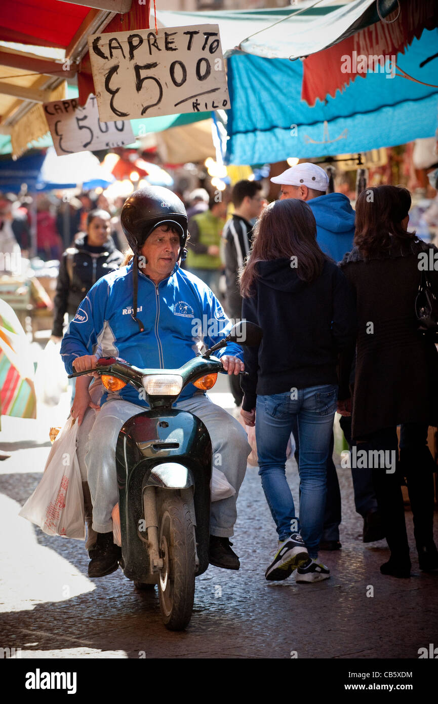 Man on scooter at 'Ballaro' Markets in the historic centre of Palermo, Sicily, Italy - Stock Image