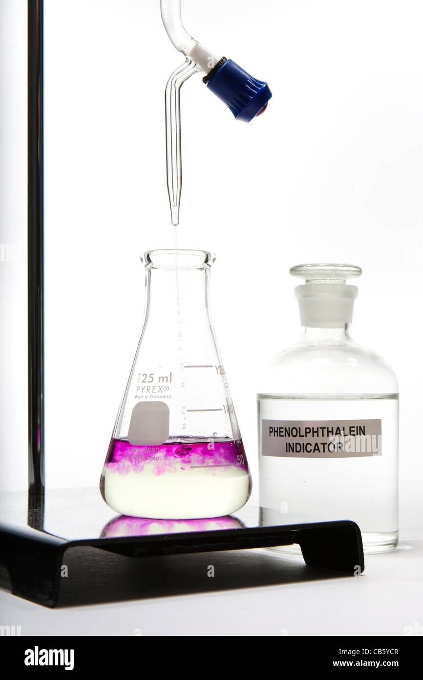 Base titrated into acid containing phenolphthalein as an indicator of pH.  See also CB5YCR. - Stock Image