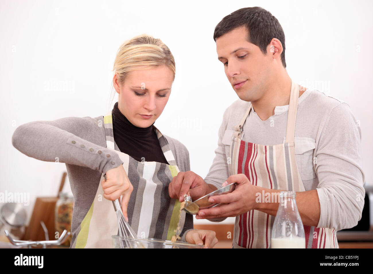 husband-and-wife-whisking-mixture-CB5YPJ