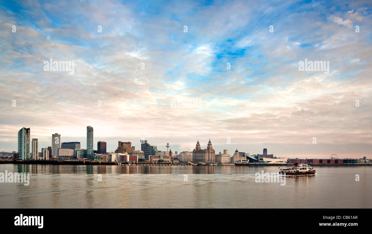 Ferry crossing the River Mersey in front of the Liverpool city skyline - Stock Image