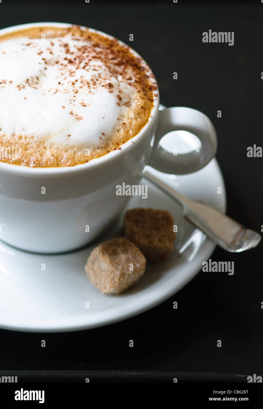 Cappuccino in white cup - Stock Image