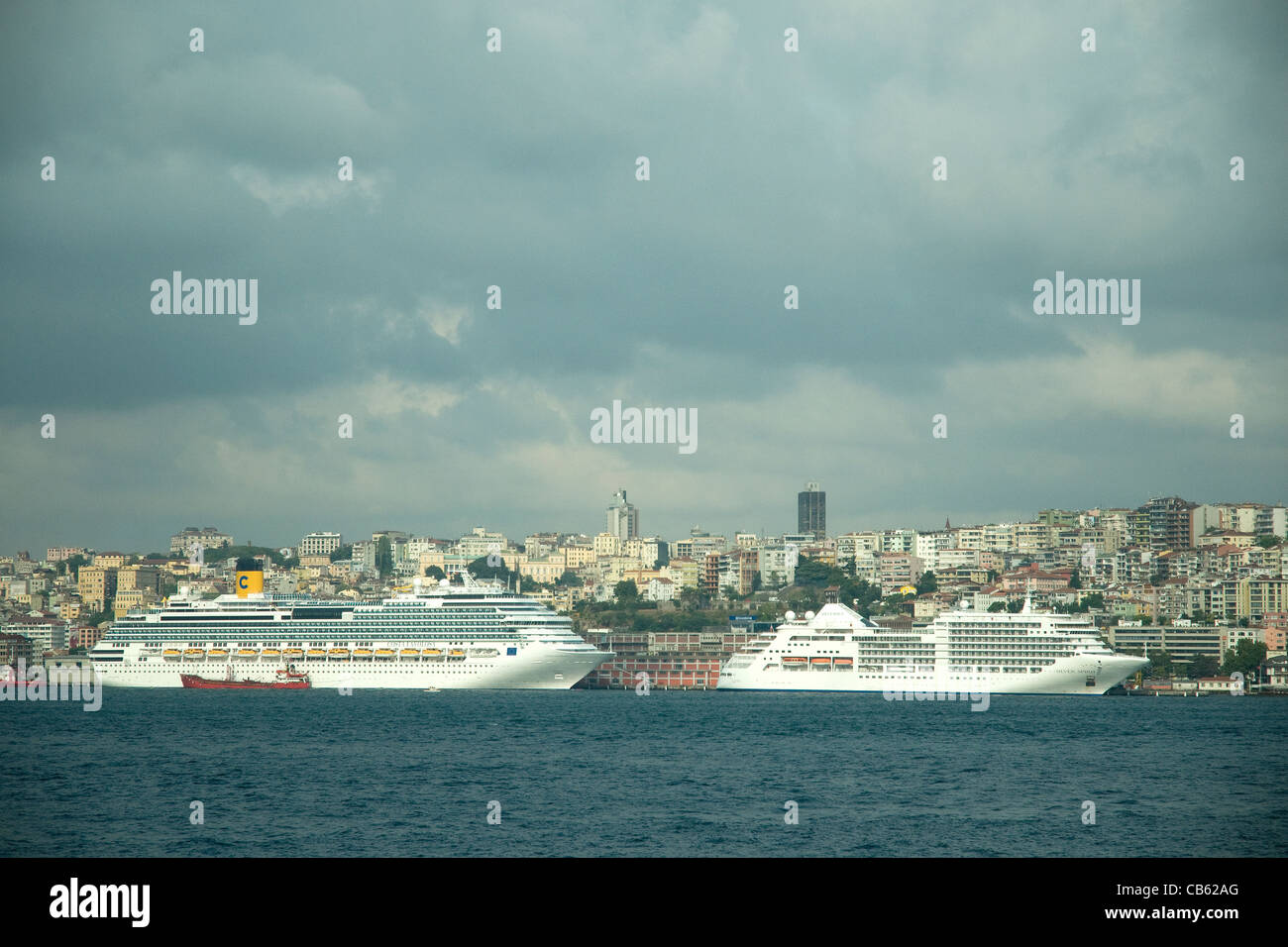 Cruise ships line Istanbul's waterfront, reflecting the ancient city's massive 21st-century tourism - Stock Image