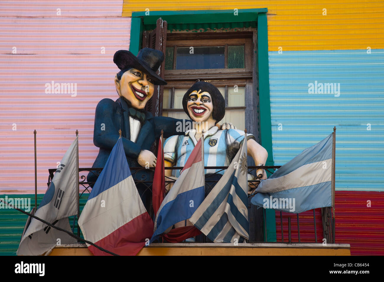 Large figure of Diego Maradona on a balcony in the colourful La Boca neighbourhood of Buenos Aires, Argentina - Stock Image