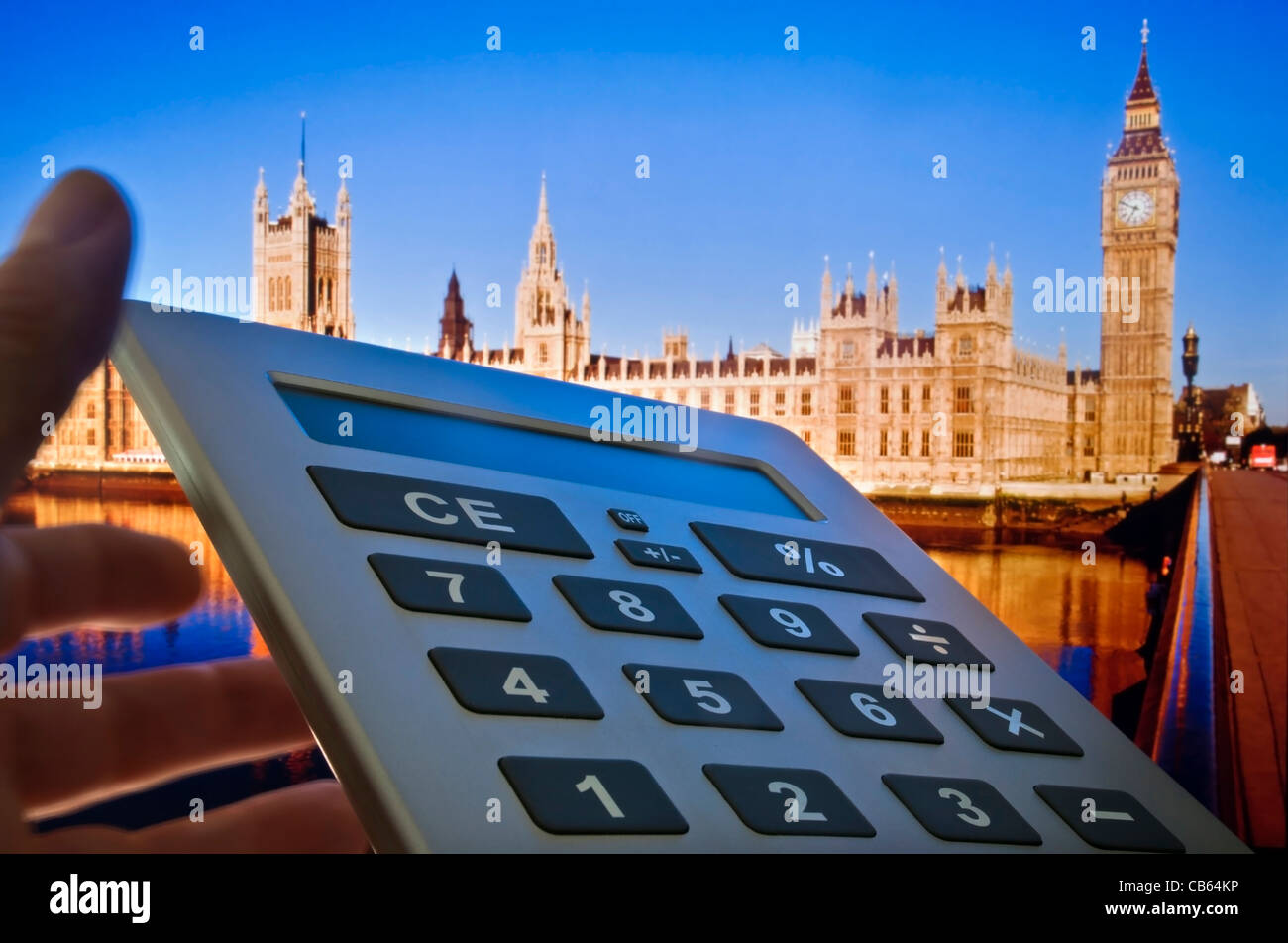 Concept image of calculator and Houses of Parliament in background Westminster London UK - Stock Image