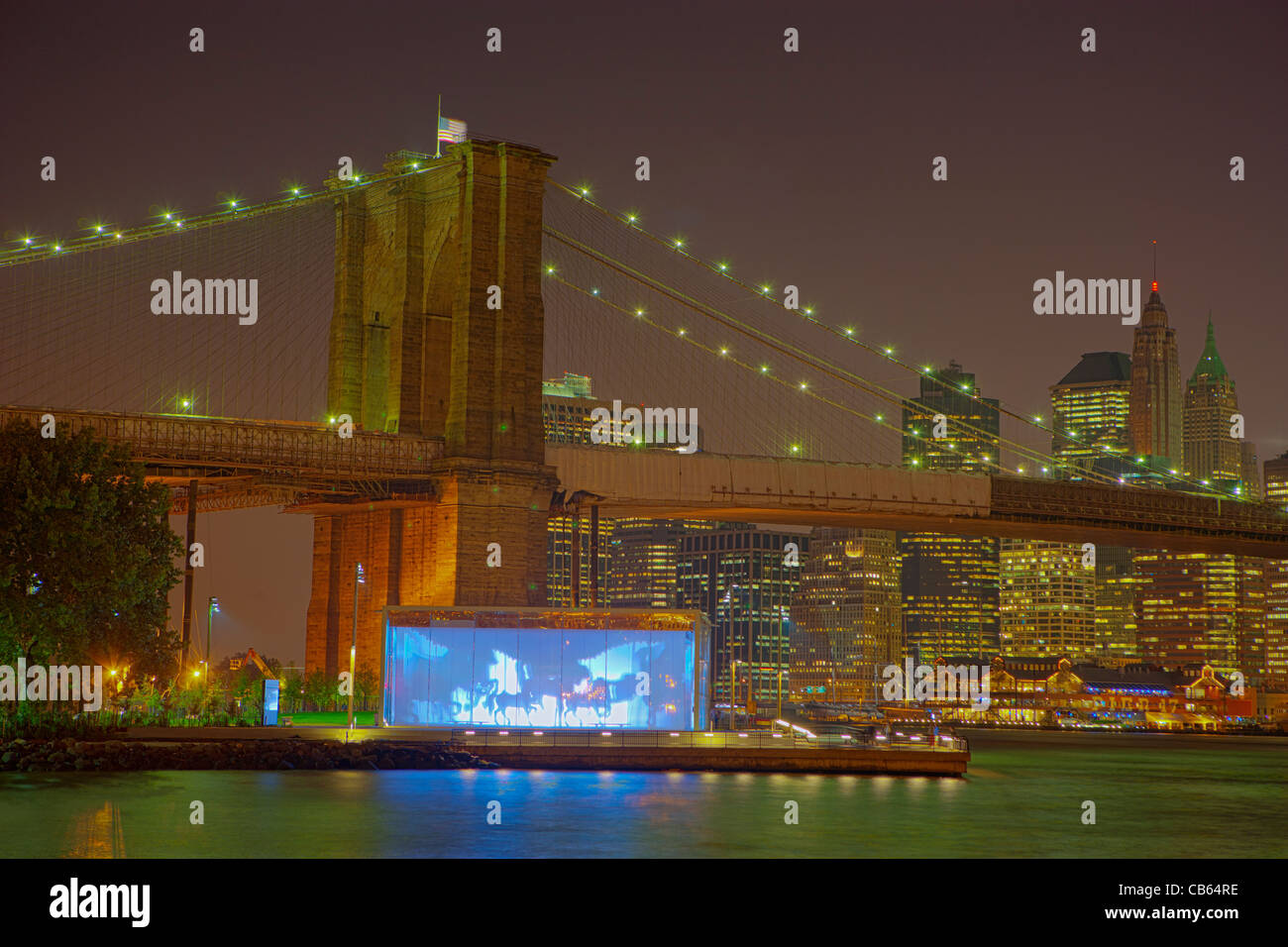 Jane's carousel under the Brooklyn Bridge - Stock Image