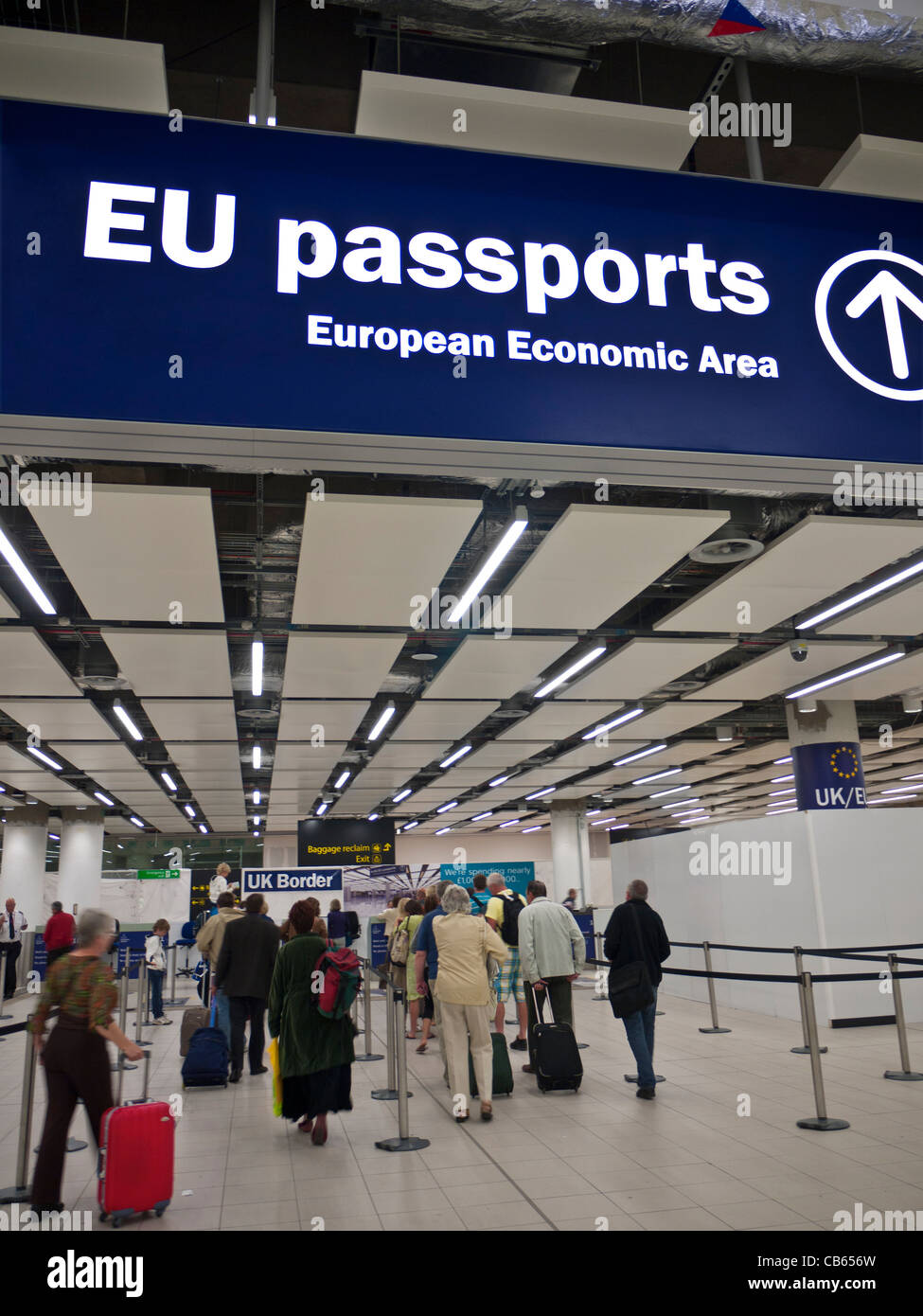 UK Border Control for EU passports at London Gatwick airport with arriving passengers awaiting clearance - Stock Image