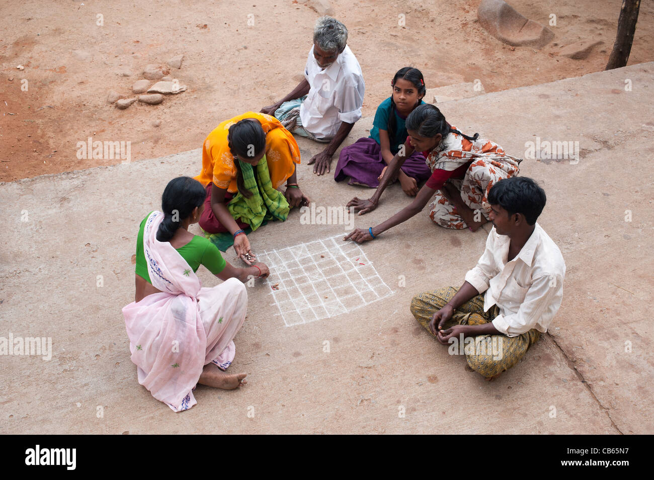 indian village people playing a game in the street. Andhra Pradesh, India - Stock Image