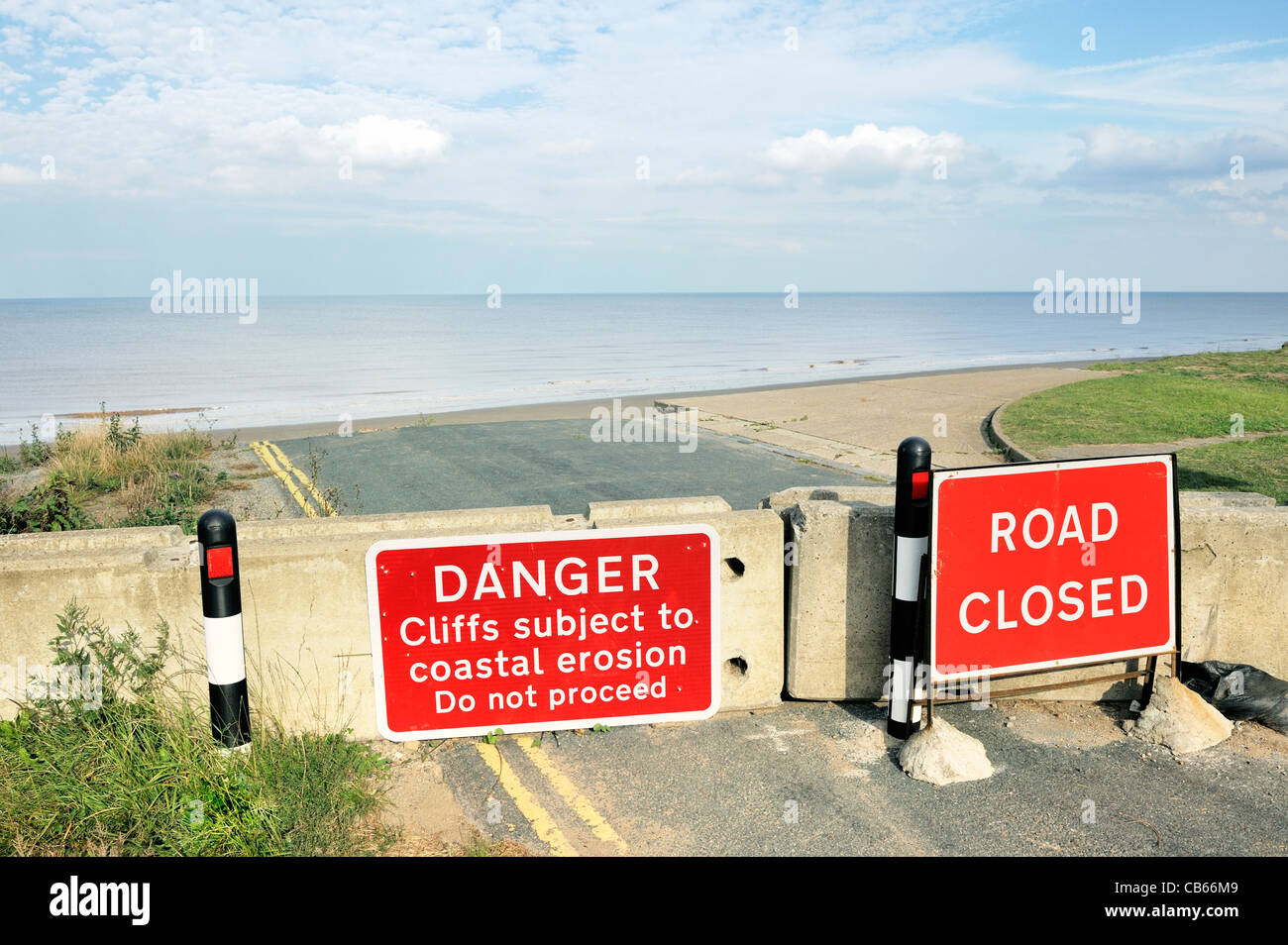 North Sea cliff coastal erosion. The coast road east of Aldbrough, East Yorkshire, England comes to an abrupt end Stock Photo