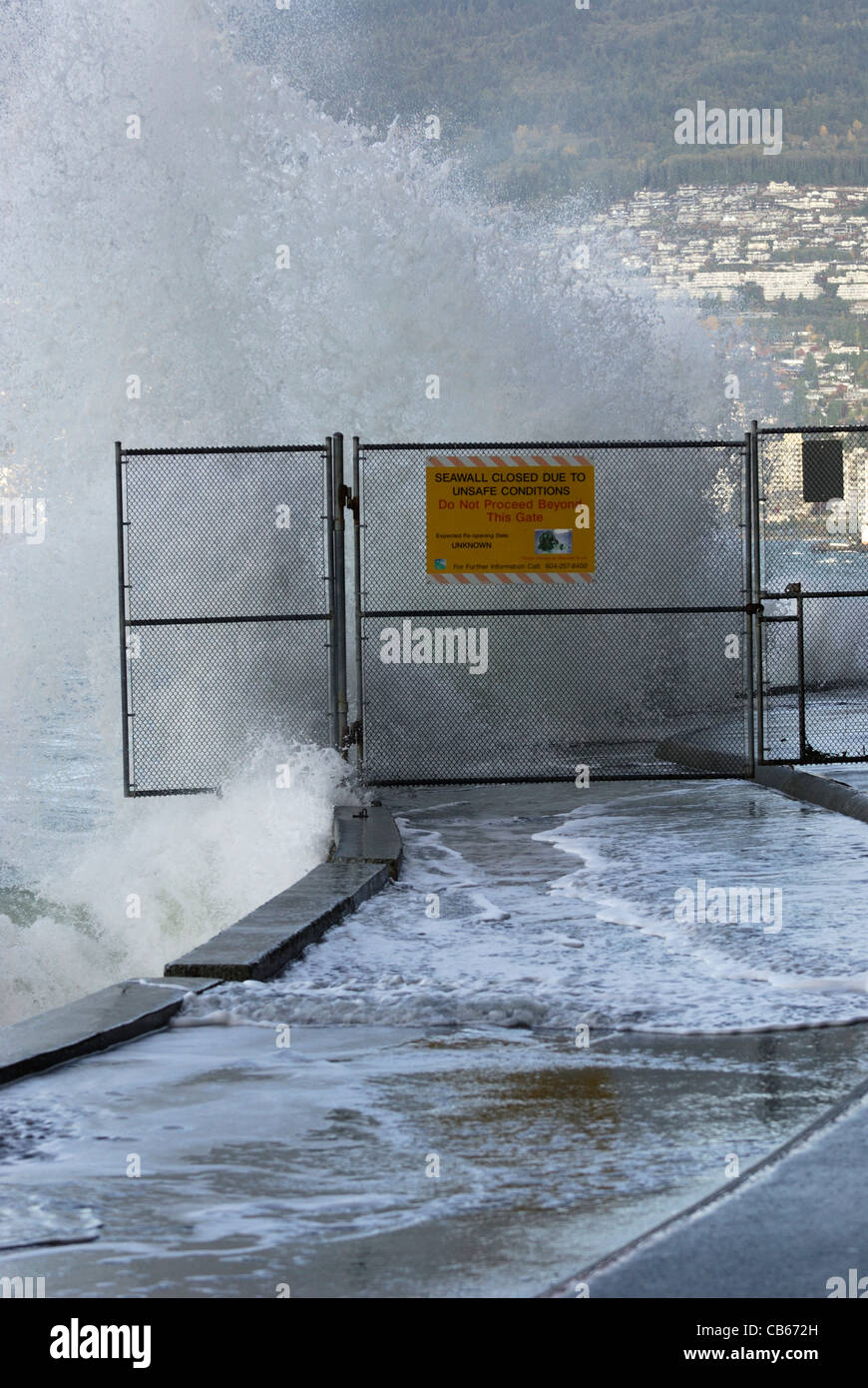 Gate closure prohibits access to the Stanley Park seawall due to the crashing of high waves during a daylight wind - Stock Image