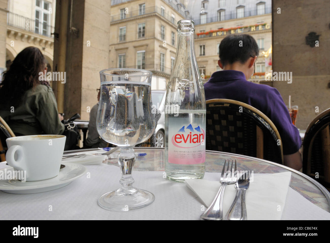 Evian bottled water sitting on a restaurant table in Paris, France. - Stock Image