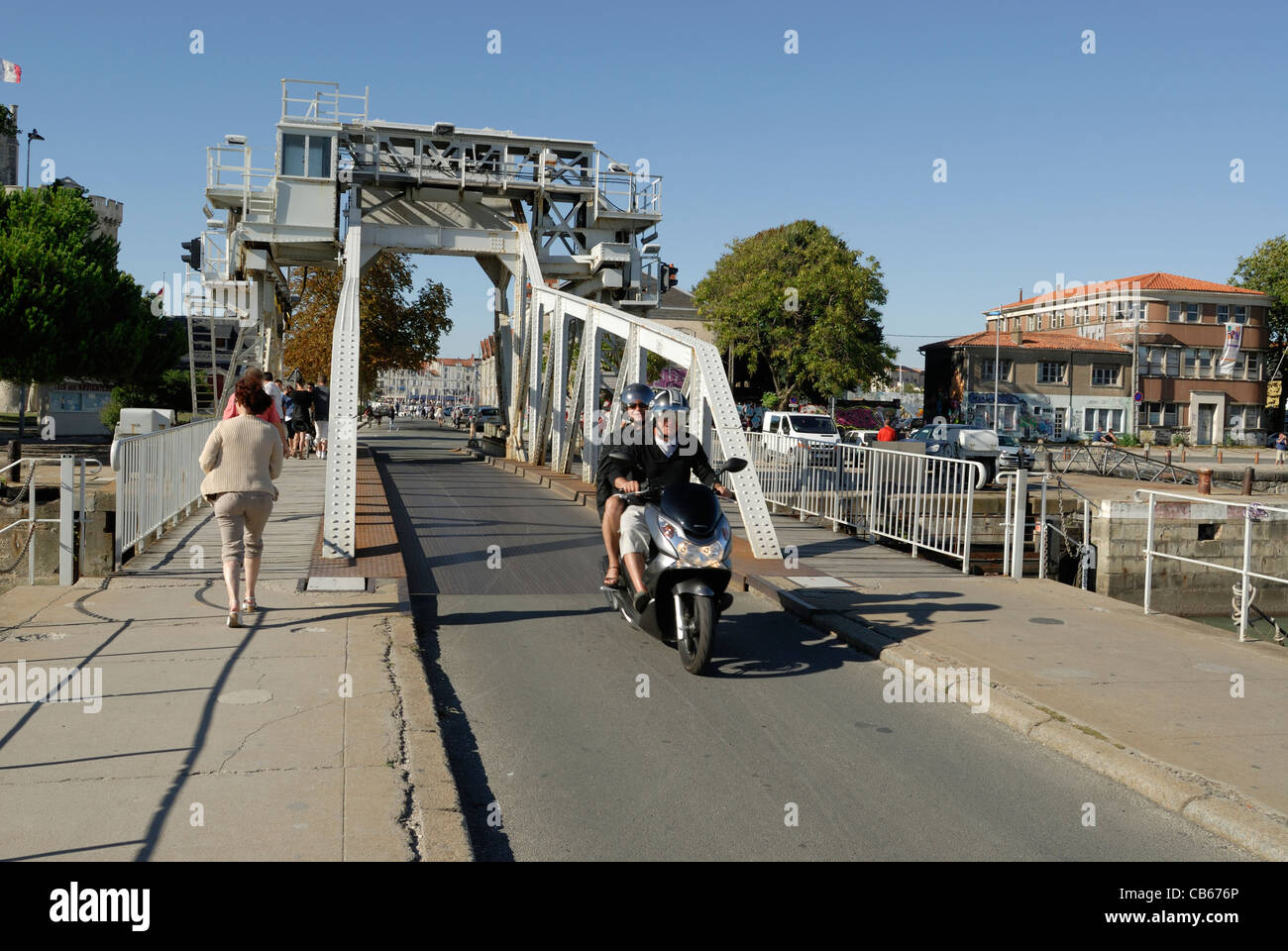 Gabut Bascule rolling Bridge is down allowing pedestrians and vehicles to cross the waterway to the inner harbour, - Stock Image