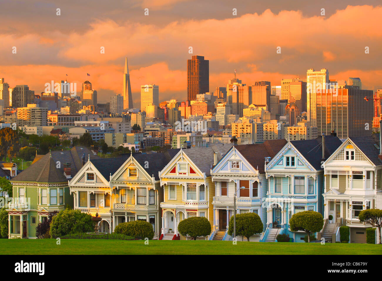 A stunning stormy sunset over Alamo Square's famous Painted Ladies, also known as Postcard Row or the Full House - Stock Image